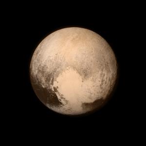 Pluto proudly shows its heart.  (Courtesy of NASA/APL/SwRI)