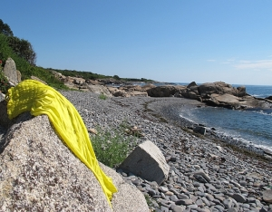 A yellow dress lies on a rock at the beach in Biddeford, Maine, on Aug. 27, 2015.