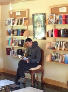 Jeremy reads one of the books at the visitors' center at the Most Holy Trinity Monastery in Petersham, Mass.