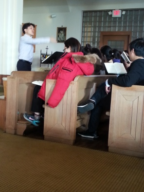The Korean choir practices before the 4 p.m. young adult Mass on Sunday, Feb. 21, 2016.