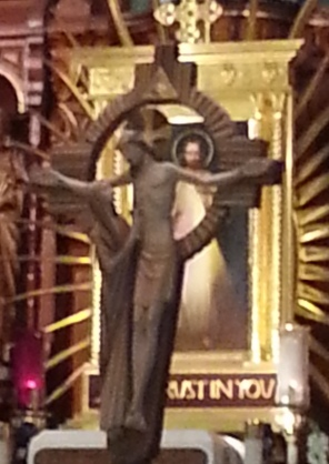 The crucifix displays the physical depths of Jesus' love while the image of Divine Mercy shows the spiritual fruits of that love.