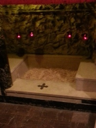 A replica of the manger in Bethlehem maintains the tradition of leaving it empty at the Franciscan Monastery in Washington, D.C., on Saturday, July 16, 2016.
